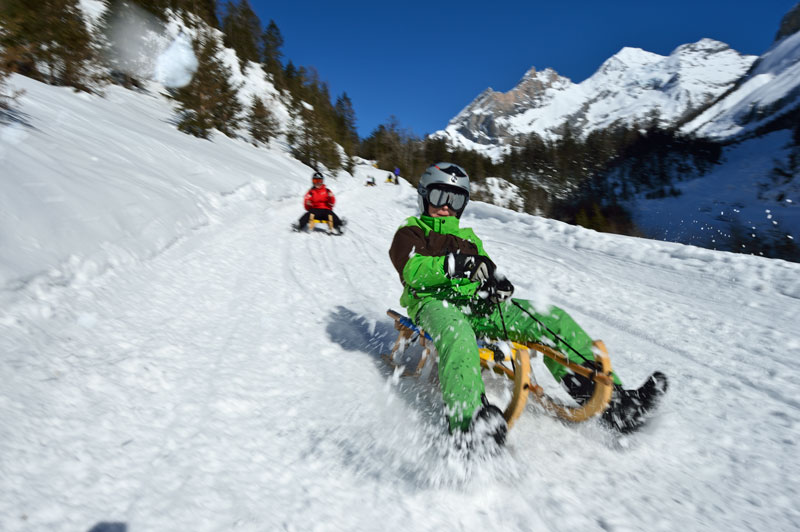 Sledding at Lake Oeschinen, Switzerland