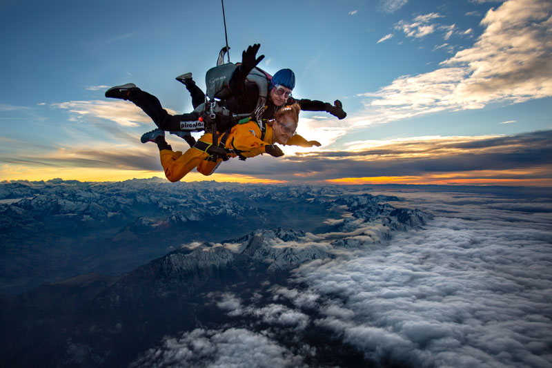 Tandem skydiving above the Swiss Alps