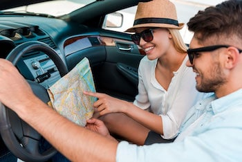 Couple looking at map in car
