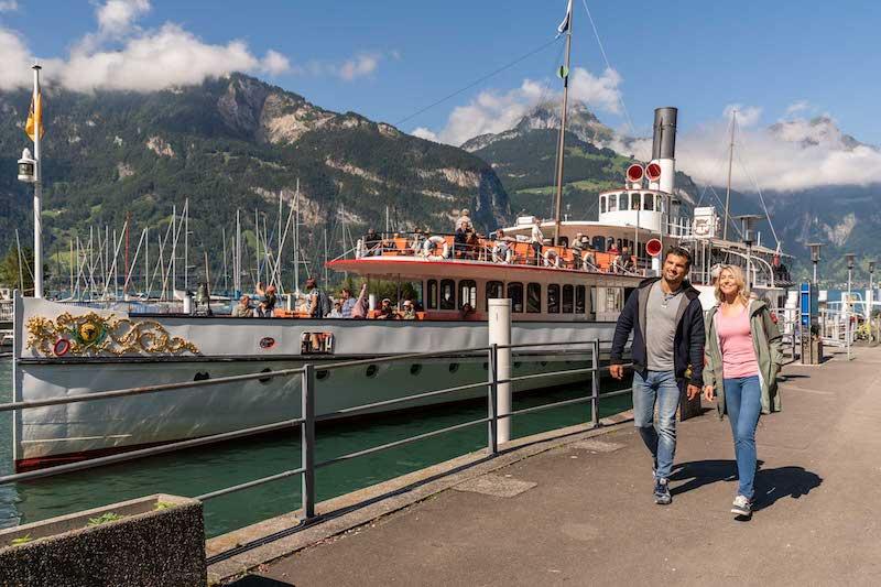 Couple beside boat pier in Fluelen.