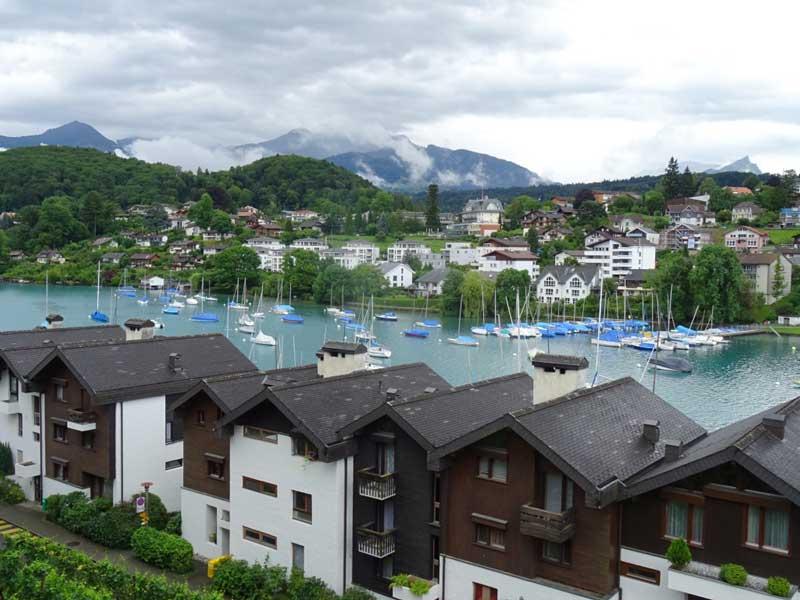 Boats moor in the harbour of Spiez on Lake Thun, Switzerland.
