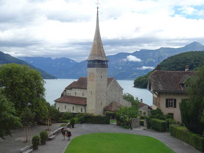 View of church and Lake Thun from Spiez Castle tower.